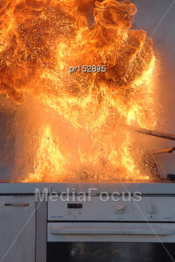 Flames From Adding Water To Burning Oil On A Kitchen Stove # 1 Stock Photo