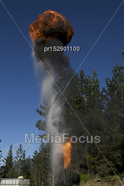 Flare Burning Off Gas And Oil At An Exploratory Oil Well, West Coast, South Island, New Zealand Stock Photo
