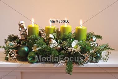 Flower Arrangement & Green Candles Stock Photo