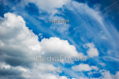 Fluffy White Clouds In A Blue Sky Background Stock Photo