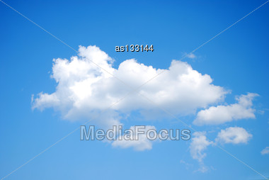 Fluffy White Clouds On Blue Sky Stock Photo