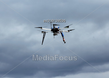 Flying Drone In The Sky With Mounted Digital Camera Stock Photo