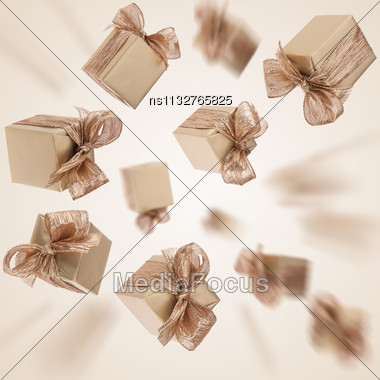 Flying Gold Gifts Background Stock Photo