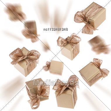 Flying Gold Gifts Isolated On White Background Stock Photo