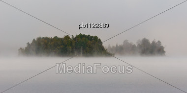 Foggy Morning Obscures Islands In Minnesota's White Iron Lake Stock Photo