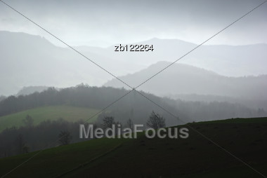 Foggy And Rainy Mountain Landscape, Dull And Cloudy Sky In Background. Stock Photo