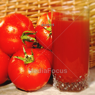 Food Backgrounds With Fresh Tomatoes And Glass Of Juice Stock Photo