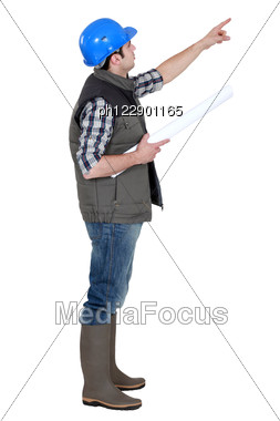 Foreman Pointing Into The Distance Stock Photo