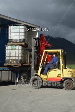 Forklift Dirver Unloads A Truck Stock Photo
