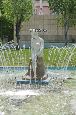 Fountain With Seated Woman Stock Photo