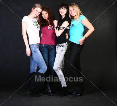Four 20-25 Years Women Friends Having Fun In Studio Stock Photo