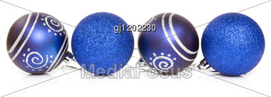 Four Blue Cristmas Baubles Over A White Background. Stock Photo