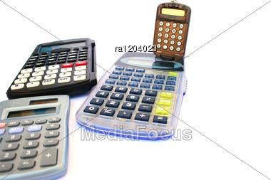 Four Calculators Stock Photo