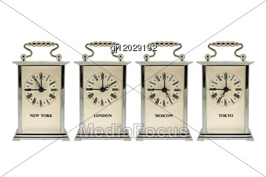 Four Clocks Shows The Different Time Zones Stock Photo