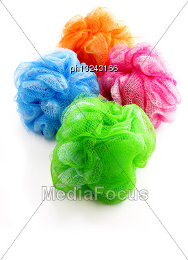 Four Colorful Shower Scrubbers Stock Photo