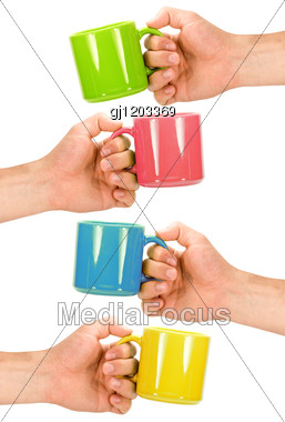 Four Hands With Colorful Cups Stock Photo