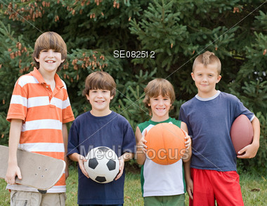 Four Kids With Sports Balls Stock Photo