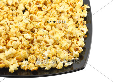 Fragment Of Plate With Fresh Caramel Popcorn. Isolated Stock Photo