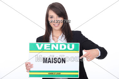 French Estate Agent With A 'Vendu' Sign Stock Photo