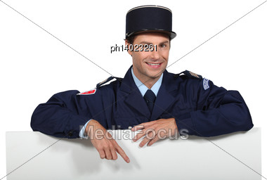 French Policeman Pointing At White Board Stock Photo