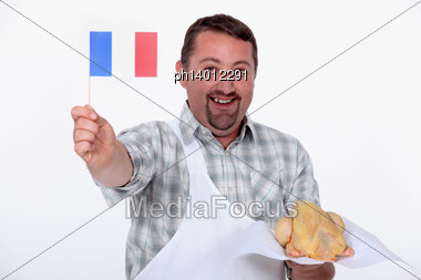 Frenchman Proudly Waving The Flag Over His Uncooked French Chicken Stock Photo