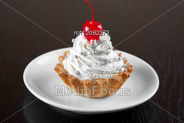 Fresh Baked Cherry Cupcake On A Dark Wooden Background Stock Photo