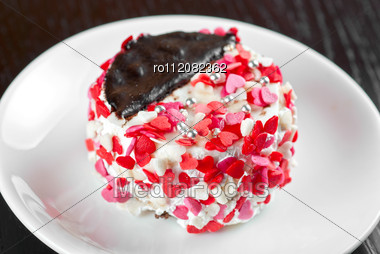 Fresh Baked Cupcake With Hearts On A Wooden Table Stock Photo