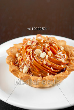 Fresh Baked Cupcake With Nuts On A Wooden Table Stock Photo