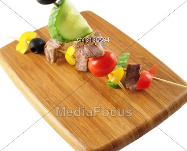 Fresh Beef Steak With Vegetables On A Cutting Board Stock Photo