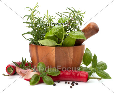 Fresh Flavoring Herbs And Spices In Wooden Mortar Isolated On White Background Stock Photo