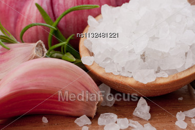 Fresh Herbs And Salt Spoon On Vintage Wooden Background. Shallow Focus Stock Photo