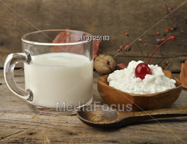 Fresh Milk And Cottage Cheese On Wooden Background Stock Photo