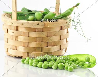 Fresh Peas In A Basket Stock Photo