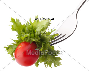 Fresh Salad And Cherry Tomato On Fork Isolated On White Background Cutout. Healthy Eating Concept Stock Photo