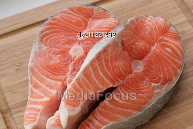 Fresh Salmon - Red Fish On Desk In Kitchen Stock Photo