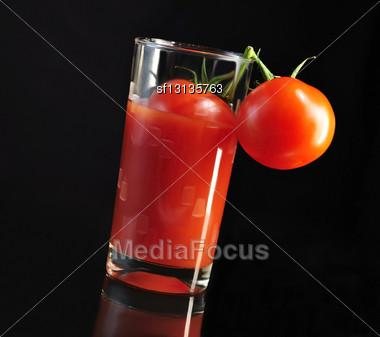 Fresh Tomatoes And Tomato Juice On Black Background Stock Photo