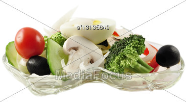 Fresh Vegetable Salad In A Glass Dish On White Background Stock Photo
