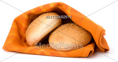 Fresh Warm Bread Over Kitchen Towel Isolated On White Background Stock Photo
