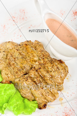 Fried Chicken Steak With Greens And Lettuce Stock Photo