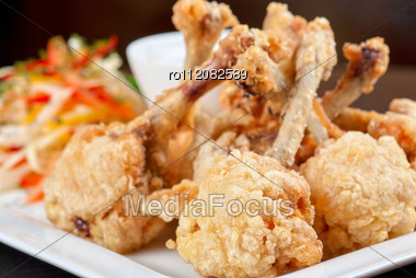 Fried Chicken Wings Garnished With Fresh Vegetables With Teriyaki Sauce Stock Photo