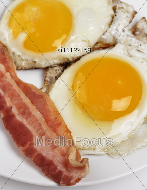 Fried Eggs And Bacon ,Close Up Stock Photo