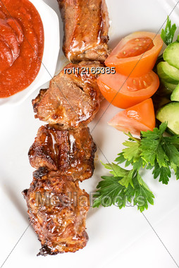 Fried Kebab Meat With Vegetables And Sauce Stock Photo