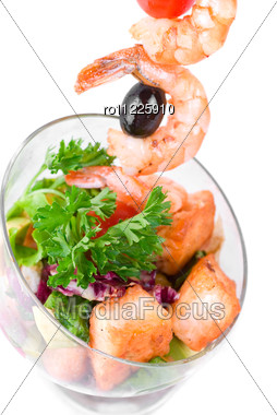 Fried Kebab Of Shrimps With Vegetables, Greens And Salmon Fish Stock Photo