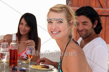 Friends Eating Dinner Alfresco Stock Photo