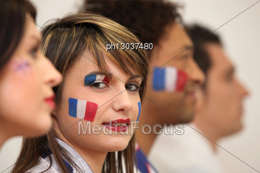Friends Watching The French Team Play A Soccer Game Stock Photo