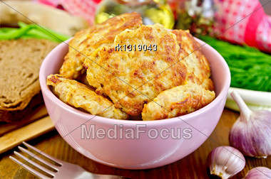 Fritters Minced Chicken In A Pink Bowl, Red Napkin, Fork, A Bottle Of Oil, Dill, Garlic, Ginger, Green Onions, Bread On A Wooden Board Stock Photo