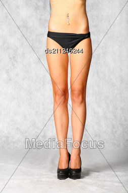 Front Side Of Legs Of Sexy Girl In Black Panties On Gray Background Stock Photo