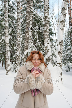 Frozen Red-haired Woman On Winters Day In Forest. Stock Photo