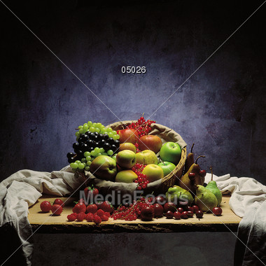 Fruit Basket On Table Still-Life Arrangement Stock Photo