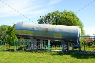 Fuel Tanks On A Background Of Plants And The Blue Sky Stock Photo